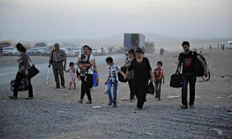 Thousands of Yazidi and Christian people flee to Erbil after the latest wave of Isis advances
