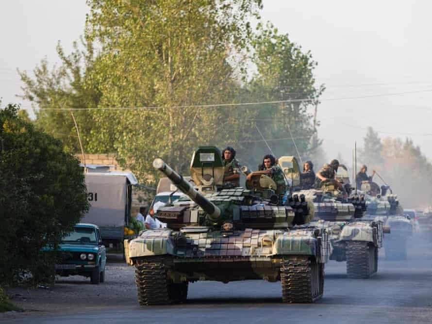 A convoy of Azerbaijan's army tanks moves in the direction of Agdam, Azerbaijan, on 2 August. Recent days have seen a sharp escalation in fighting around Nagorno-Karabakh.