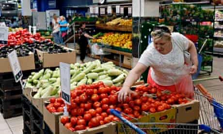 A Russian woman buys tomatoes at a Moscow supermarket