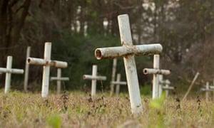 White metal crosses mark graves at the cemetery of the former Arthur G Dozier School for Boys florida