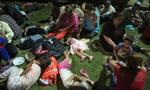 Displaced people taking shelter at St Joseph Church in Irbil, northern Iraq, after Islamist militants overran a cluster of predominantly Christian villages.