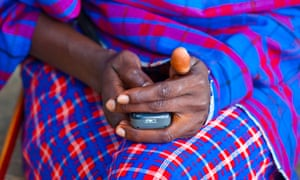 Maasai tribesman using a mobile phone