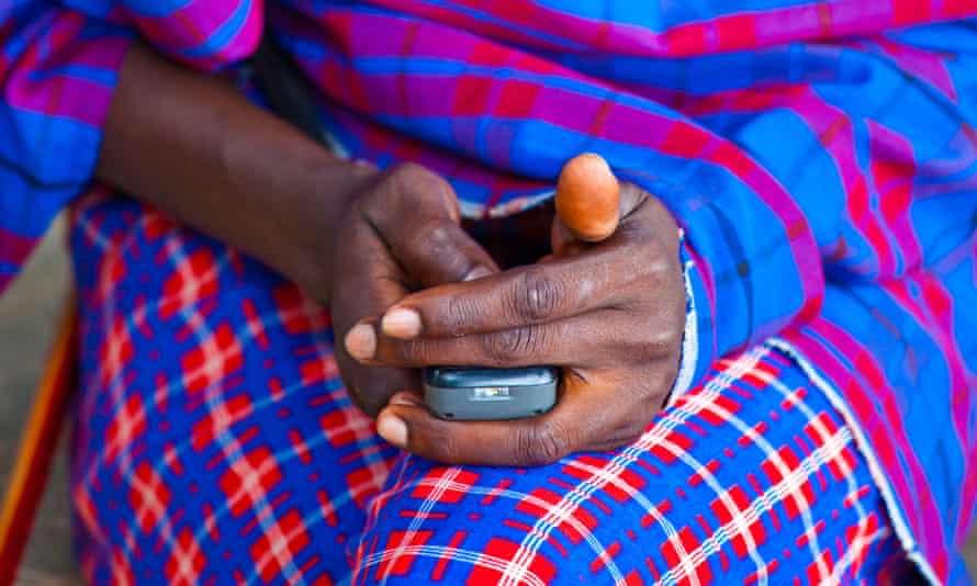 Maasai tribesman using a mobile phone