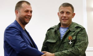 Alexander Borodai, left, shakes hands with Alexander Zakharchenko, who has been put forward as the new Prime Minister of the self-declared 'Donetsk People s Republic'.