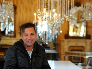 Antique dealer Jason Delos in the chapel of the once derelict Catholic girls' school that he has painstakingly restored.