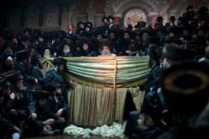 Ultra-Orthodox Jews gather for the traditional Jewish wedding for Chananya Yom Tov Lipa, in the Israeli town of Petah Tikva near Tel Aviv, Israel.