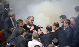 Deputies of Ukraine's parliament fight in smoke bombs during a session in Kiev, 2010.