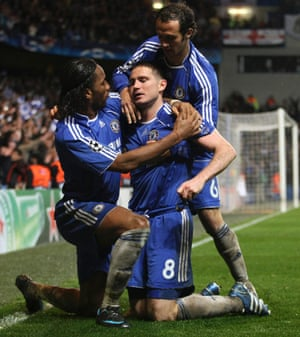 Chelsea's Frank Lampard is congratulated by Didier Drogba and Ricardo Carvalho after scoring against Liverpool during their Champions League second leg semi final soccer match at Stamford Bridge Stadium, 2008.