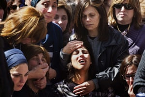 The mother of seven-year-old Miriam Monsonego mourns during the funeral of her daughter and three other victims of Toulouse school shooting, at the Givat Shaun cemetery in Jerusalem, 2012.