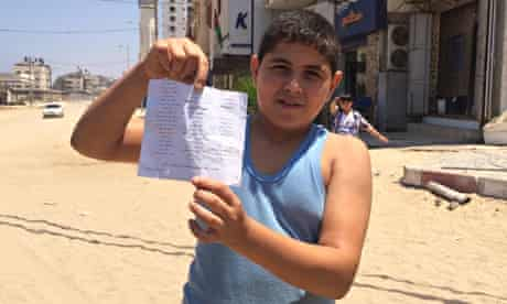 A boy in Gaza with a leaflet dropped from an F16 aircraft.