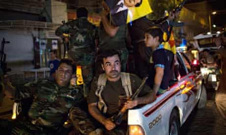 Peshmergas and Kurds show readiness to fight Isis on streets of Erbil in northern Iraq