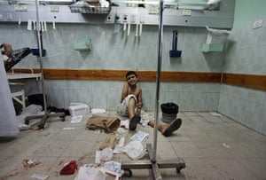 20 Photos: A Palestinian boy waits to be treated at the Kamal Adwan hospital in Gaza