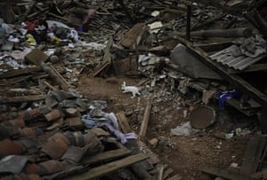 20 Photographs: A rabbit amid the rubble after a massive earthquake in Longtoushan, China