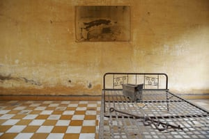 20 Photographs: A photograph hangs in a room once used as a torture chamber, Phnom Penh