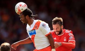Blackpool's Nathan Delfouneso wins and flattens the ball with his head, leaving Nottingham Forest's Danny Fox behind him at the City Ground, Nottingham.