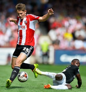 Brentford's James Tarkowski tussles with the floored  Igor Vetokele of Charlton Athletic in their match at Griffin Park.