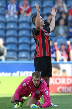 Yann Kermorgant makes it 3-0 with the dejected Huddersfield Town goalkeeper Alex Smithies on his knees.