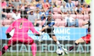 Wigan's Callum McManaman has a shot at goal against Reading.