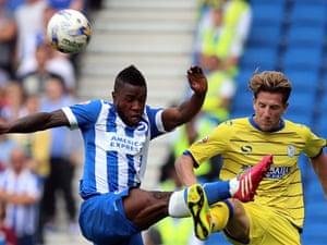 Brighton's Kazenga LuaLua, left, is crosses legs with Sheffield Wednesday's Sam Hutchinson at the AMEX Stadium, Brighton.