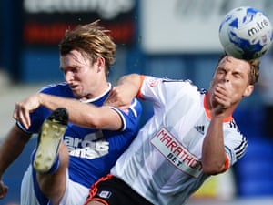 Both Fulham's Scott Parker and Ipswich's Jay Tabb lose sight of the ball.