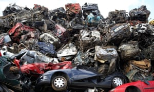Piles of crushed cars at a metal recycling site in Belfast, Northern Ireland.