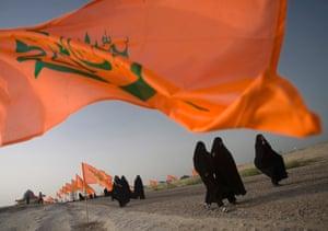 Iranian women visit a war memorial in Khuzestan province