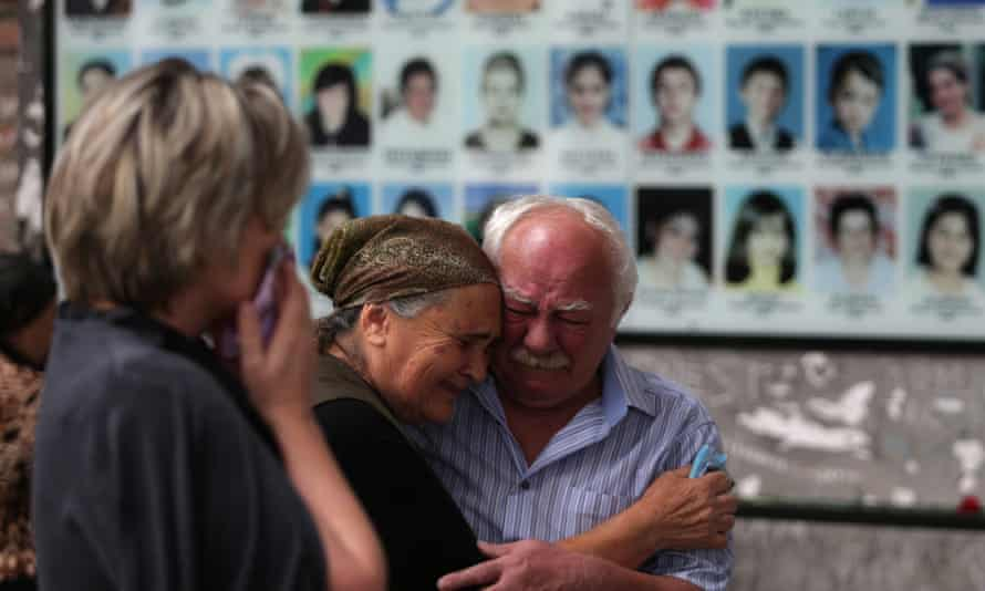 Mourners come to School No 1 to remember the victims of the 2004 Beslan school siege