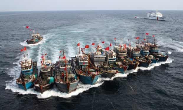 A fleet of illegal Chinese fishing vessels attempts to evade the South Korean Coast Guard