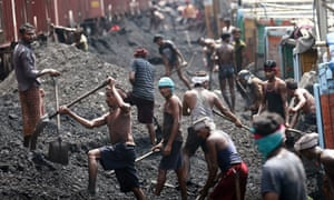 Indian labourers load coal into trucks at a coal warehouse in Bari Bharmana railway station about 20 Km from the northern city of Jammu, India, 23 August 2012. India's opposition lawmakers disrupted Parliament sessions on the past two days and demanded Premier Manmohan Singh's resignation following a report that the country lost 33 billion dollars by allocating coal mine licenses instead of auctioning them.