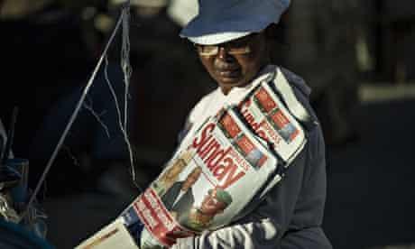 A newspaper seller in Maseru
