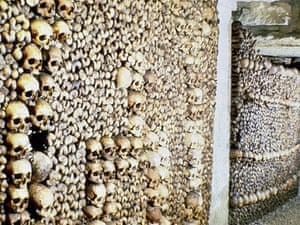 The Paris catacombs, which contain the bones of 6 million people. It is now a tourist spot where visitors confront death for pleasure.