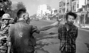 South Vietnamese National Police Chief Brig Gen. Nguyen Ngoc Loan executes a Viet Cong officer with a single pistol shot in the head.