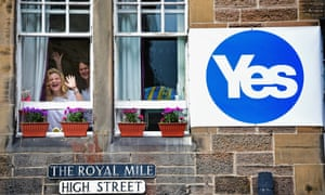 EDINBURGH, SCOTLAND - SEPTEMBER 09: Two women wave from a window of a property on the Royal Mile on September 9, 2014.
