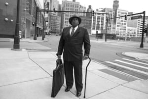 Day #33 A native Detroiter poses on Gratiot Avenue in downtown Detroit