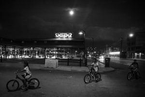 Day #280 Children ride their bikes at night in Eastern Market