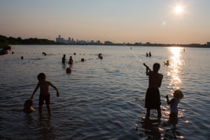 Day #484 Children play in the water at sunset on Belle Isle