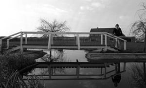 March 1980 Trevor Francis stands on a bridge over his pond in the garden of his home in Newark