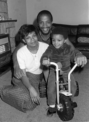 West Bromwich Albion and England's Cyrille Regis with his wife Beverley and son Robert in their home.