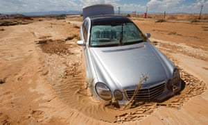 A Mercedes sedan is pictured partially submerged in mud in the median of Interstate 15 near Glendale, Nevada.
