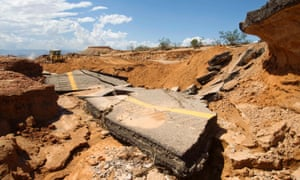 The damaged southbound lanes of Interstate 15 are pictured in pieces near Moapa, Nevada.