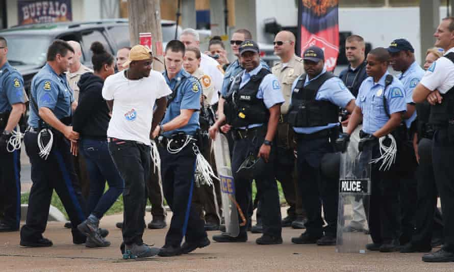 Police arrest a demonstrator during a protest along interstate highway 70 on 10 September  near Ferguson, Missouri.