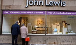 A couple look into the window of a John Lewis store in Edinburgh, Scotland