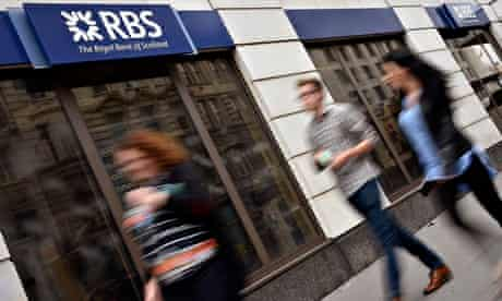 People walk past a branch of The Royal Bank of Scotland in central London