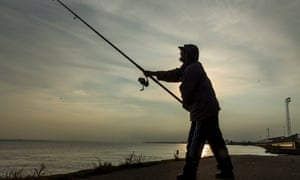 A fisherman on the River Humber alongside the Alexandra Dock in Hull.