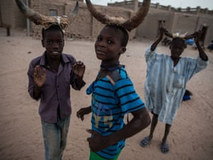 "Children wearing horns play a kind of ""trick or treat"" during the first phase of Ramadan"