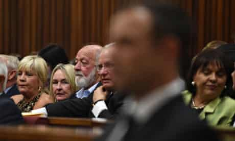 Reeva Steenkamp's mother, June, sits next to husband Barry as she looks at Oscar Pistorius in court