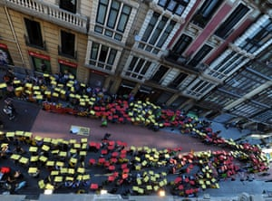 People holding placards with the colours of the Catalan flag demonstrate in Bilbao for independence from Spain