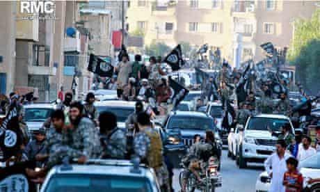 Fighters from Islamic State parade in Raqqa, Syria