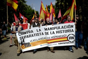 Anti-independence Catalans hold Spanish flags and a banner reading 'against separatist manipulation of history' during a demonstration in Barcelona for Spanish unity