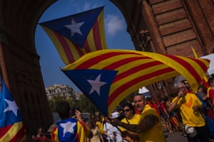 A man waves an estelada flag - a symbol of Catalan separatism - in Barcelona